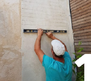 תכנון וסימון הקיר לפני ישום הבריקים